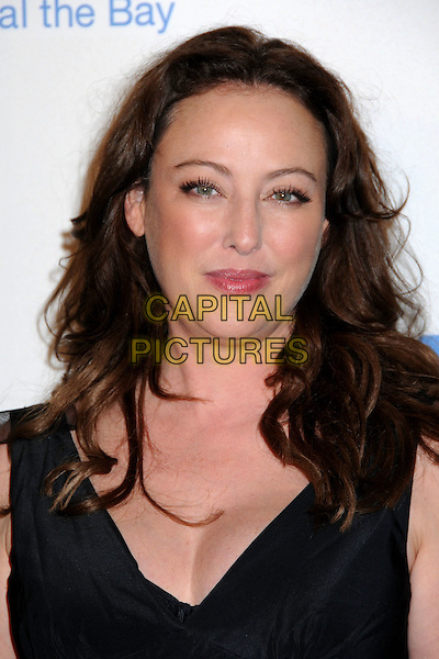 VIRGINIA MADSEN.Cirque du Soleil's KOOZA Opening Night Gala held at the Santa Monica Pier, Santa Monica, California, USA..October 16th, 2009.headshot portrait black .CAP/ADM/BP.©Byron Purvis/AdMedia/Capital Pictures.
