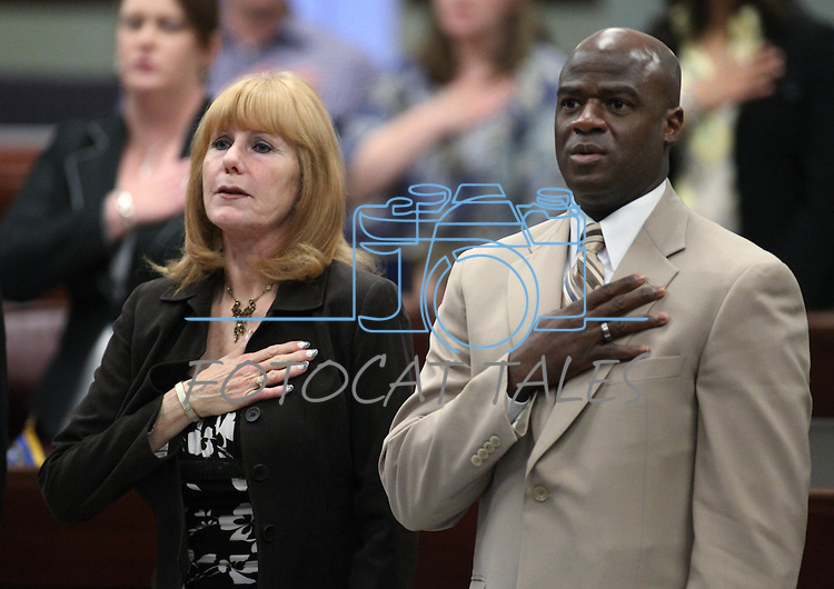 Guest Lynne Hansen says the Pledge of Allegiance with Assemblyman Kelvin Atkinson, D-North Las Vegas, on the Assembly floor Friday morning, May 6, 2011, at the Legislature in Carson City, Nev..Photo by Cathleen Allison
