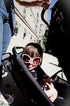Little Girl wearing sunglasses sitting in her stroller