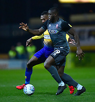 Lincoln City's John Akinde battles with  Mansfield Town's Krystian Pearce<br /> <br /> Photographer Andrew Vaughan/CameraSport<br /> <br /> The EFL Sky Bet League Two - Mansfield Town v Lincoln City - Monday 18th March 2019 - Field Mill - Mansfield<br /> <br /> World Copyright © 2019 CameraSport. All rights reserved. 43 Linden Ave. Countesthorpe. Leicester. England. LE8 5PG - Tel: +44 (0) 116 277 4147 - admin@camerasport.com - www.camerasport.com