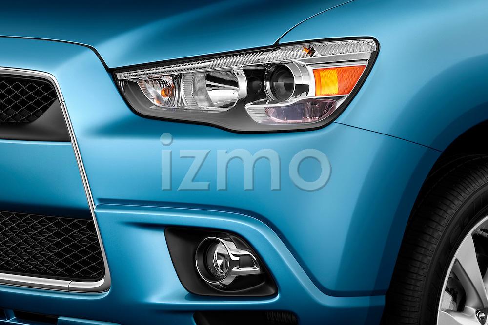 Headlight detail view of a 2012 Mitsubishi Outlander Sport