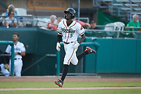Eric Jenkins (5) of the Down East Wood Ducks jogs towards home plate after hitting a home run against the Winston-Salem Dash at Grainger Stadium Field on May 17, 2019 in Kinston, North Carolina. The Dash defeated the Wood Ducks 8-2. (Brian Westerholt/Four Seam Images)