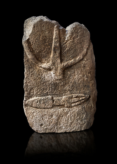 Late European Neolithic prehistoric Menhir standing stone with carvings on its face side. The representation of a stylalised male figure starts at the top with a long nose from which 2 eyebrows arch around the top of the stone. below this is a carving of a falling figure with head at the bottom and 2 curved arms encircling a body above. at the bottom is a carving of a dagger running horizontally across the menhir. Excavated from S'Arretzraxiu, Laconi. Menhir Museum, Museo della Statuaria Prehistorica in Sardegna, Museum of Prehoistoric Sardinian Statues, Palazzo Aymerich, Laconi, Sardinia, Italy. Black background.