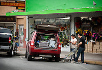 A couple fill the back of their car with goods after shopping in downtown McAllen, Texas, Sunday, April 4, 2010. Trade with Mexico is flourishing in this town despite the spike in drug-related violence south of the border. Downtown McAllen stores don't sell designer or name brand items, but still reach a wide customer base for McAllen residents and visiting Mexican tourists. ...PHOTO/ Matt Nager