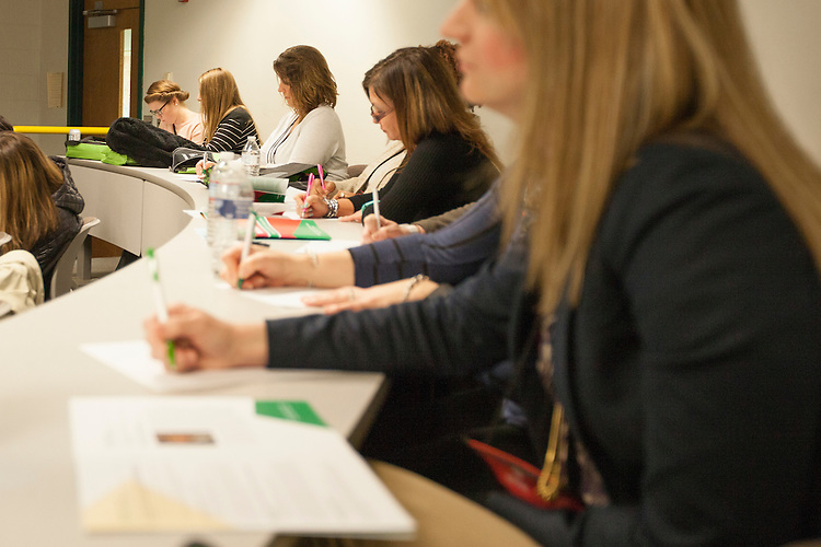 Women take notes during a lecture at the 10th Annual Celebrate Women Conference at Ohio University Lancaster Campus on Friday, March 18, 2016. Photo by Kaitlin Owens