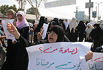 """Palestinian women attend a protest calling for doctors to stop their strike, in the southern Gaza strip. At 11am each day, all pro-Fatah doctors suspend work and leave hospitals. Hamas officials of the ministry of health said the move hindered services for the public and endangered lives of patients in need for urgent medical attention. Pro-Fatah doctors have been on partial strike for over a week and plan to continue for the coming two weeks in protest for what they called Hamas """"intervention and take over"""" of the ministry of health in Gaza."""