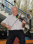 Paddy Reilly playing his Stroh violin at the ceilí and set dancing at Brú na Boinne, an instrument he has played for nearly 50 years. Photo: Colin Bell/pressphotos.ie