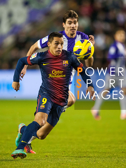 VALLADOLID, SPAIN - DECEMBER 22:  Alexis Sanchez of FC Barcelona runs with the ball during the La Liga game between Real Valladolid and FC Barcelona at Jose Zorrilla on December 22, 2012 in Valladolid, Spain.  Photo by Victor Fraile / The Power of Sport Images