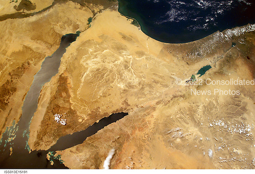 Wide angle view of Israel (right center), the Sinai Peninsula (center), the Nile River (upper left), the Suez Canal (top left), the Mediterranean Sea, (top right), and the Dead Sea (center right), taken aboard the International Space Station on May 5, 2006.  Center Point Latitude: 30.5 Center Point Longitude: 35.0 (Negative numbers indicate south for latitude and west for longitude).Credit: NASA via CNP