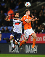Blackpool's Matty Virtue vies for possession with Bolton Wanderers' Jason Lowe<br /> <br /> Photographer Kevin Barnes/CameraSport<br /> <br /> The EFL Sky Bet League One - Bolton Wanderers v Blackpool - Monday 7th October 2019 - University of Bolton Stadium - Bolton<br /> <br /> World Copyright © 2019 CameraSport. All rights reserved. 43 Linden Ave. Countesthorpe. Leicester. England. LE8 5PG - Tel: +44 (0) 116 277 4147 - admin@camerasport.com - www.camerasport.com