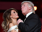 "United States President Donald Trump singing along to ""My Way"" dances with First Lady Melanie Trump while attending the Freedom Inaugural Ball at the Walter E. Washington Convention Center on January 20, 2017 in Washington, D.C.  Trump will attend three inaugural balls. <br /> Credit: Kevin Dietsch / Pool via CNP"