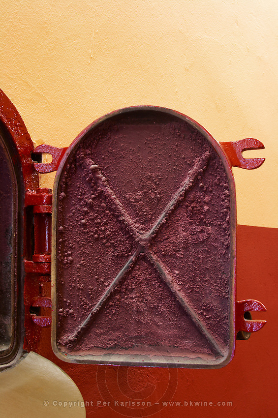 Fermentation tanks. Door with red crystal deposits. Amyntaion wine cooperative, Amyndeon, Macedonia, Greece