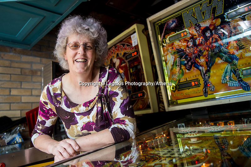 COPY BY TOM BEDFORD<br /> Pictured: Elaine Rolfe with some of the pinball machines.<br /> Re: Pinball widow Elaine Rolfe from Abergavenny, south Wales, whose late husband David left her 30 pinball machines.