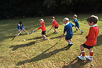 Schoolchildren playing hockey during their sports lesson in the school playing fields. They are being instructed by a PE teacher. This image may only be used to portray the subject in a positive manner..©shoutpictures.com..john@shoutpictures.com