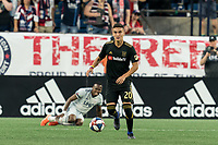 FOXBOROUGH, MA - AUGUST 3: Eduard Atuesta #20 of Los Angeles FC brings the ball forward during a game between Los Angeles FC and New England Revolution at Gillette Stadium on August 3, 2019 in Foxborough, Massachusetts.