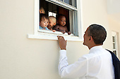 """June 9, 2011.""""The President had attended the fourth grade closing ceremony for her daughter Sasha at her school in Bethesda, Maryland.  As he was departing, he noticed some pre-school children peering out of a window at a child care facility adjacent to the Sasha's school so he walked over to say hello to them.""""  President Barack Obama greets children at a day care facility adjacent to daughter Sasha's school in Bethesda, Md., following her 4th grade closing ceremony, June 9, 2011..Mandatory Credit: Pete Souza - White House via CNP"""