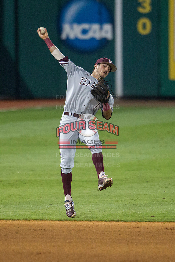Texas A&M Aggies shortstop Blake Allemand (1) makes a difficult throw to first base during a Southeastern Conference baseball game against the LSU Tigers on April 24, 2015 at Alex Box Stadium in Baton Rouge, Louisiana. LSU defeated Texas A&M 9-6. (Andrew Woolley/Four Seam Images)