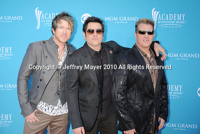 LAS VEGAS, Nevada - April 18: Musicians Joe Don Rooney, Jay DeMarcus and Gary LeVox of Rascall Flatts arrives for the 45th Annual Academy of Country Music Awards at the MGM Grand Garden Arena on April 18, 2010 in Las Vegas, Nevada.