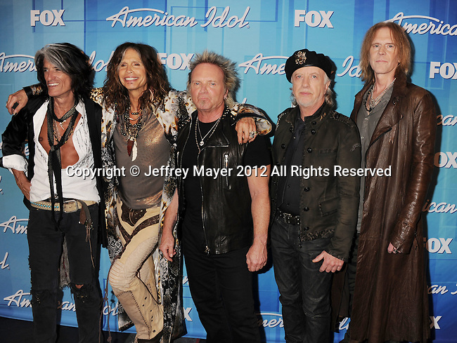 """LOS ANGELES, CA - MAY 23: Joe Perry, Steven Tyler, Joey Kramer, Brad Whitford, and Tom Hamilton of Aerosmith pose in the press room during """"American Idol Season 11 Grand Finale"""" Show at Nokia Theatre L.A. Live on May 23, 2012 in Los Angeles, California."""