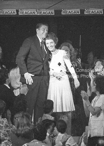 Former Governor Ronald Reagan (Republican of California), a candidate for the the 1976 Republican nomination for President of the United States, and his wife, Nancy, appear at the Republican National Convention at the Kemper Arena in Kansas City, Missouri on August 19, 1976.<br /> Credit: Arnie Sachs / CNP