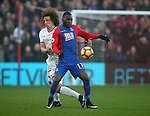 Crystal Palace's Christian Benteke tussles with  Chelsea's David Luiz during the Premier League match at Selhurst Park Stadium, London. Picture date December 17th, 2016 Pic David Klein/Sportimage