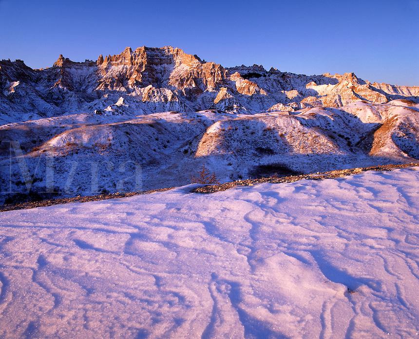 Drifted snow and bad lands, Badlands National Park, South Dakota