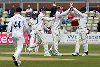 Simon Harmer of Essex celebrates with his team mates after taking the wicket of Travis Head during Worcestershire CCC vs Essex CCC, Specsavers County Championship Division 1 Cricket at Blackfinch New Road on 12th May 2018