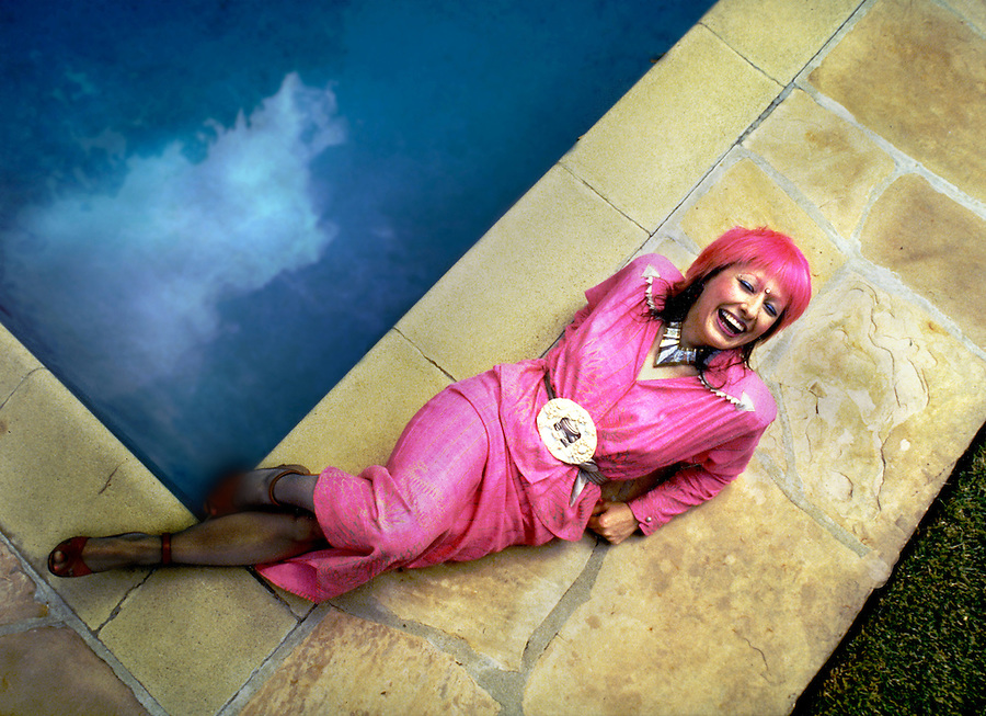 Zondra Rhodes who was the first person to popularize vibrantly colored hair, poses by the backyard pool outside her temporary residence in Beverly Hills, CA.