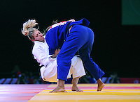 Scotland's Gemma Gibbons (wearing white) in action during her victory over Seychelles' Brigitte Rose in the women's -78kg quarter-final<br /> <br /> Photographer Chris Vaughan/CameraSport<br /> <br /> 20th Commonwealth Games - Day 3 - Saturday 26th July 2014 - Judo - SECC - Glasgow - UK<br /> <br /> © CameraSport - 43 Linden Ave. Countesthorpe. Leicester. England. LE8 5PG - Tel: +44 (0) 116 277 4147 - admin@camerasport.com - www.camerasport.com