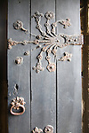 Ornate metalwork hinges on the door to the Percy family chapel, Tynemouth priory,  Northumberland, England