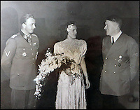 BNPS.co.uk (01202 558833)<br /> Pic: Marlows/BNPS<br /> <br /> Hitler with Eva Braun's sister Gretl and her new husband Hermann Fegelein.<br /> <br /> Taken just three days before D-Day this remarkable photo shows Adolf Hitler celebrating the wedding of his brother-in-law - who he had executed a year later.<br /> <br /> The previously unseen image shows the Nazi dictator congratulating Hermann Fegelein and bride Gretl Braun, little realising that the course of the Second World War was about to turn against him.<br /> <br /> It was found in a gallery of 12 snaps of the wedding reception that lasted for thee days and was organised by Eva Braun, the elder sister of Gretl and Hitler's mistress.<br /> <br /> The fuhrer was one of the witnesses to the marriage along with SS chief Heinrich Himmler and Martin Bormann, Hitler's private secretary.<br /> <br /> The 12 black and white photos taken at her first wedding have sold at Marlows auctioneers of Stafford for &pound;400.