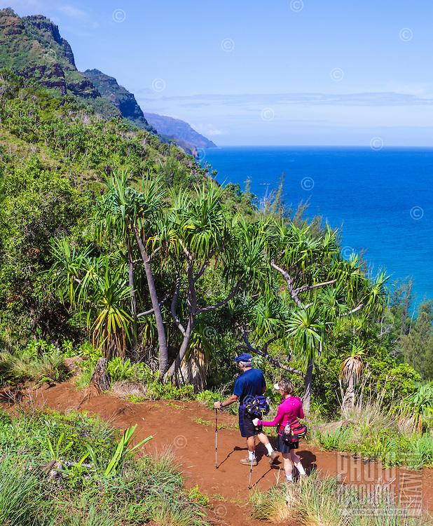 An older couple hikes the Kalalau Trail on Kaua'i.