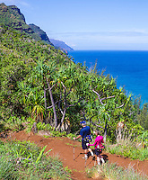 An older couple hikes the Kalalau Trail on Kaua'i.