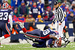 New England Patriots runningback Corey Dillon (28) is tackled by linebacker London Fletcher (59) after a gain against the Buffalo Bills at Ralph Wilson Stadium in Orchard Park, NY, on December 11, 2005 . The Patriots defeated the Bills 35-7. Mandatory Photo Credit: Ed Wolfstein
