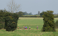 28 SEP 2014 - STOWMARKET, GBR - Competitors pick their way through the countryside during the 5km run of the 2014 West Suffolk Triathlon in Stowmarket in Suffolk, Great Britain (PHOTO COPYRIGHT © 2014 NIGEL FARROW, ALL RIGHTS RESERVED)