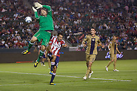 Philadelphia Union goalkeeper Chris Seitz (1) looses the ball in front of his goal with CD Chivas USA midfielder Jonathan Bornstein (13) moving in. The Philadelphia Union and CD Chivas USA played to 1-1 draw at Home Depot Center stadium in Carson, California on Saturday evening July 3, 2010..