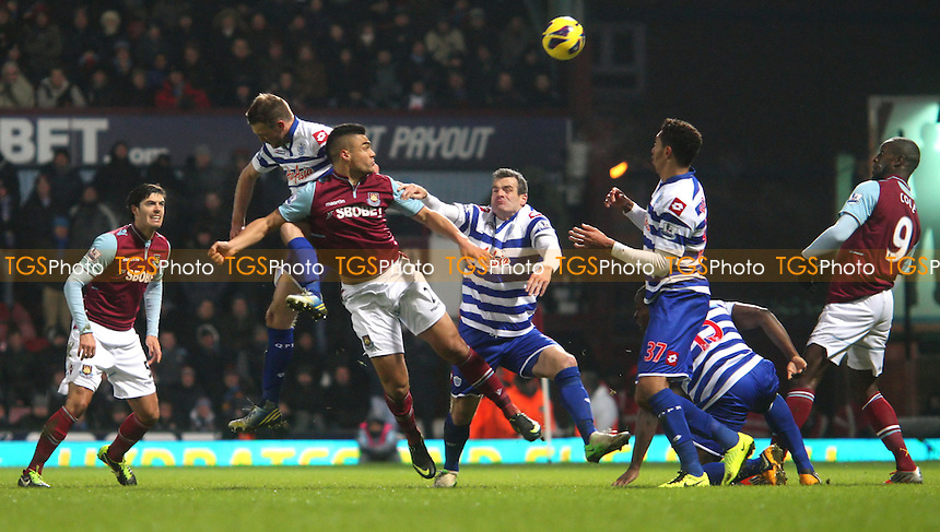 Winston Reid of West Ham gets in a header in the 2nd half - West Ham United vs Queens Park Rangers, Barclays Premier League at Upton Park, West Ham - 19/01/13 - MANDATORY CREDIT: Rob Newell/TGSPHOTO - Self billing applies where appropriate - 0845 094 6026 - contact@tgsphoto.co.uk - NO UNPAID USE.
