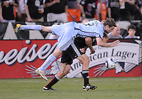 Colorado Rapids defender Drew Moor (3) fouls DC United forward Adam Cristman (7). The Colorado Rapids defeated DC United 1-0 at RFK Stadium, Saturday May 15, 2010.