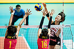 Wing spiker Rika Nomoto of Japan (R) spikes during the FIVB Volleyball World Grand Prix match between China vs Japan on July 21, 2017 in Hong Kong, China. Photo by Marcio Rodrigo Machado / Power Sport Images