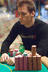 Justin Bonomo's chip stack is dwarved by Joseph Hachem's, foreground.