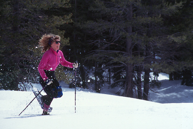 Woman running in snowshoes at Clair Tappaan (Sierra Club facility)