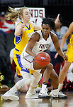 SIOUX FALLS, SD: MARCH 6: Danielle Lawrence #14 of IUPUI spins into South Dakota State defender Madison Guebert #11 during the Summit League Basketball Championship on March 6, 2017 at the Denny Sanford Premier Center in Sioux Falls, SD. (Photo by Dick Carlson/Inertia)