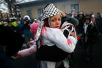 Terrified children being taken away as demonstration turn violent. The children are covered in Mock blood. Pro-Palestinian protesters clashed with police as they held another demonstration against Israel in the Norwegian capital Oslo. Violent clashes lasted for hours  in the centre of Oslo. Israeli forces began a series of air strikes on the Gaza Strip on the 27th of December in retaliation against Hamas rockets fired into Israel. After eight days of bombardment, leaving over 400 Palestinians and four Israelis dead, Israeli tanks launched a ground invasion on the 4th of January.