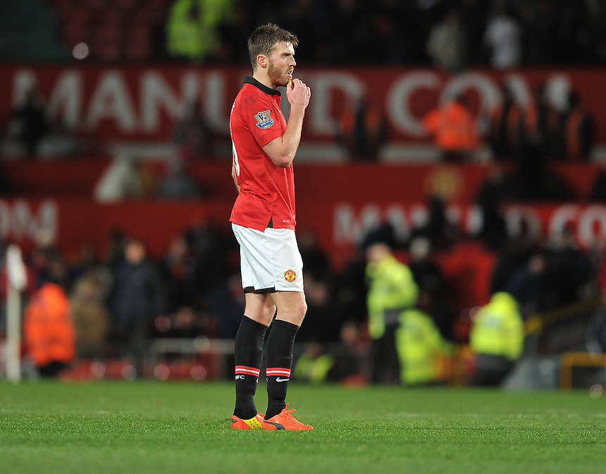 Manchester United's Michael Carrick shows his frustration at his team conceding a last minute equaliser<br /> <br /> Photo by Dave Howarth/CameraSport<br /> <br /> Football - Barclays Premiership - Manchester United v Fulham - Sunday 9th February 2014 - Old Trafford - Manchester<br /> <br /> &copy; CameraSport - 43 Linden Ave. Countesthorpe. Leicester. England. LE8 5PG - Tel: +44 (0) 116 277 4147 - admin@camerasport.com - www.camerasport.com