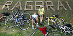 Bill and Louise Moulder of Des Moines relax on a shady hillside in the final pass through town of Alexander Tuesday late afternoon.  The couple are celebrating their 50th wedding anniversary by riding RAGBRAI together.