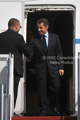 French President Nicolas Sarkozy arrives for the Nuclear Security Summit, at Andrews Air Force Base, Maryland, April 12, 2010. .Credit: Kevin Dietsch / Pool via CNP