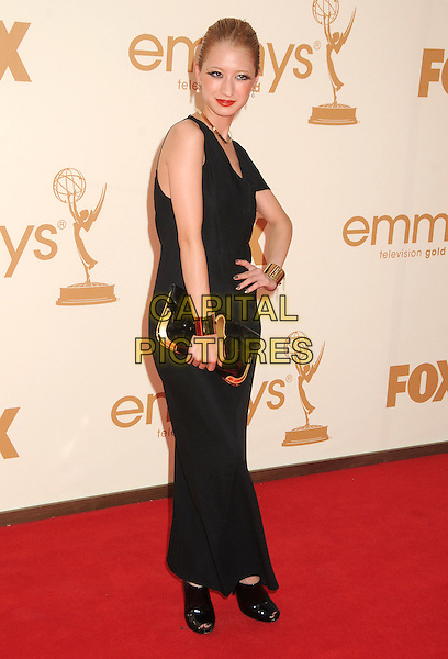 Vanessa Lengies.63rd Primetime Emmy Awards held at Nokia Theatre L.A. Live. Los Angeles, California, USA. .18th September 2011.emmys full length black dress clutch bag gold cuff bracelet hand on hip.CAP/ADM/BP.©Byron Purvis/AdMedia/Capital Pictures.