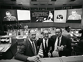 Houston, TX - (FILE) -- National Aeronautics and Space Administration (NASA) officials and engineers celebrate the Apollo 11 landing on July 20, 1969 as the CBS telecast featuring Walter Cronkite is broadcast on television screens in Mission Control. .Credit: NASA via CNP.