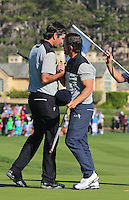 160213 Actor Mark Wahlberg with Bubba Watson on 18 after Saturday's Third Round of The AT&T National Pro Am at The Pebble Beach Golf Links in Carmel, California. (photo credit : kenneth e. dennis/kendennisphoto.com)