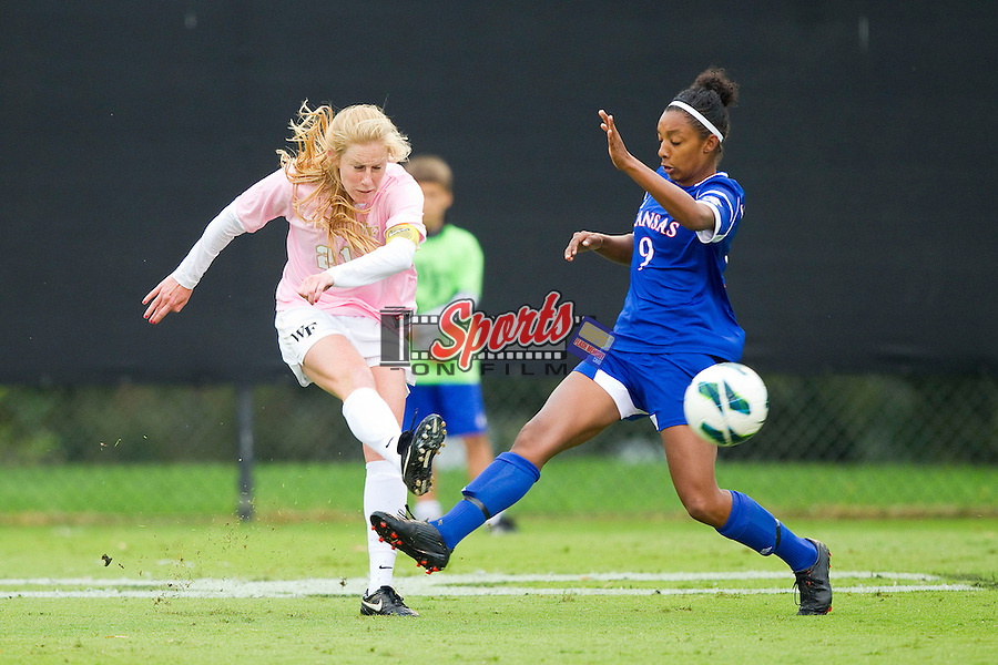 Jackie Logue (21) of the Wake Forest Demon Deacons kicks the ball away from Ashley Williams (9) of the Kansas Jayhawks at Spry Soccer Stadium on October 7, 2012 in Winston-Salem, North Carolina.  The Demon Deacons and the Jayhawks battled to a 1-1 tie in double overtime.  (Brian Westerholt/Sports On Film)
